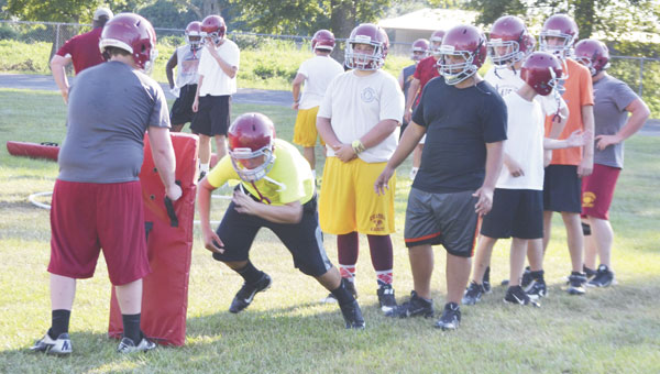 Escambia Academy players participate in a drill designed to help linemen shed their blocks, during a Monday afternoon practice session.