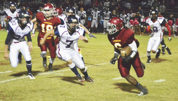 Escambia Academy's Kris Brown runs with the ball during a regular season game against Bessemer Academy last year. EA will face five teams ranked in the AISA Top 10 preseason poll in 2015, including Bessemer Academy.|File photo by Ditto Gorme, For The Advance