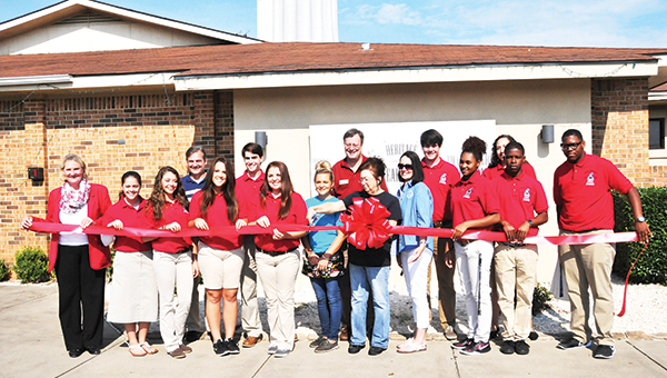 Ambassadors and officers with the Atmore Area Chamber of Commerce celebrated the ribbon cutting of Heritage Steakhouse last week. The steakhouse is located right next to Muskogee Inn right next to Interstate 65. | Andrew Garner/Atmore Advance