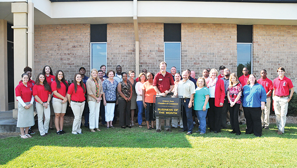 Masland Carpet was named the Atmore Area Chamber of Commerce's Business of the Month for August. Shown here are chamber ambassadors, chamber officers and employees with Masland Carpet outside of the company's manufacturing plant in Atmore. | Andrew Garner/Atmore Advance