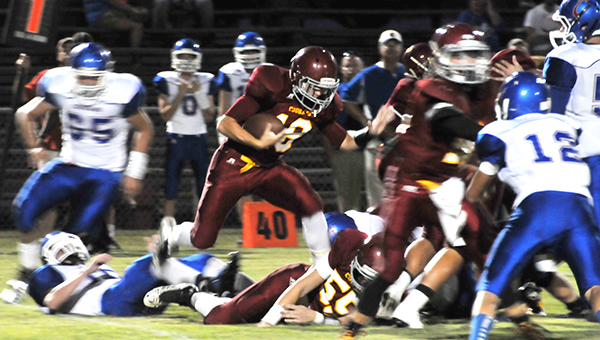 Escambia Academy's JoJo Carpenter (18) finds room during a run play tonight. | Andrew Garner/Atmore Advance