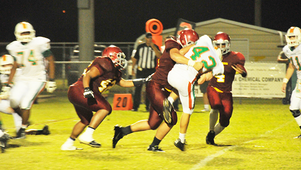 Escambia Academy's Chris Brown makes a big tackle for a loss tonight. | Andrew Garner/Atmore Advance