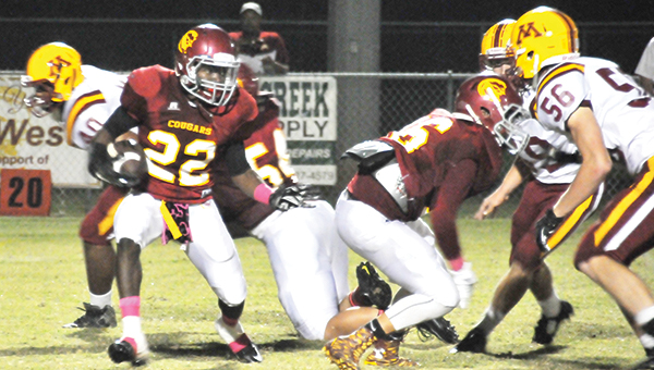 Escambia Academy's D.D. Brooks (22) looks for running room during the win over Morgan Academy. | Andrew Garner/Atmore Advance