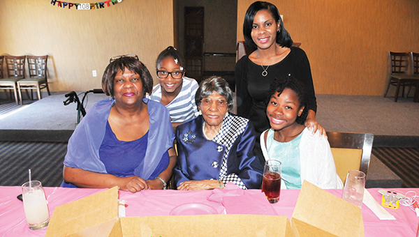 Barnetta Williams celebrated her 108th birthday on Sunday at Heritage Steakhouse in Atmore. Williams is shown here with her granddaughter, Icilda Orr; great-great granddaughter, Soiree Williams; great-granddaughter, Demietra Williams; and Jaleigha Marchman.   Andrew Garner/Atmore Advance