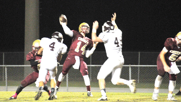 Northview's Gavin Grant (14) throws the ball against Baker during the Chiefs' final game of the regular season. | Andrew Garner/Atmore Advance