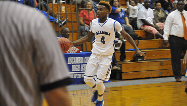 Escambia County's Anthony Fountain looks for an open man earlier tonight. | Andrew Garner/Atmore Advance