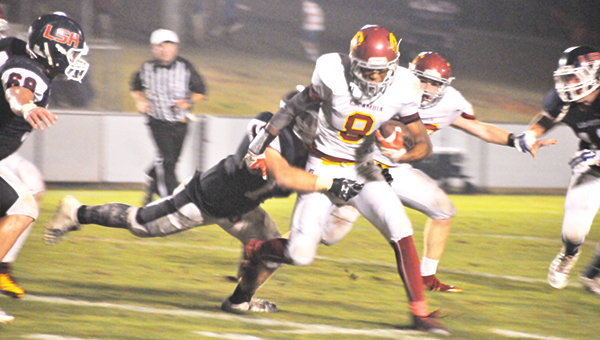 Escambia Academy's Patrick McGee (8) runs for a gain during the Cougars' loss to Lee-Scott Academy. | Andrew Garner/Atmore Advance