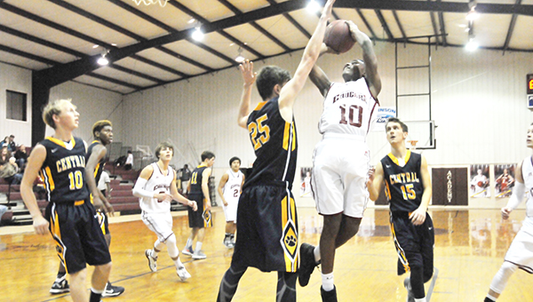 Escambia Academy's Fred Flavors goes up for a shot under the rim earlier tonight. | Andrew Garner/Atmore Advance