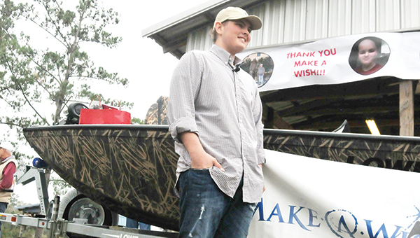 Denver Shuttlesworth talks with the media next to his new boat. | Andrew Garner/Atmore Advance