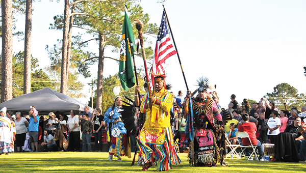 The Poarch Creek Indian and United States flags are brought out, along with the Eagle Staff during the grand entry Thursday at the 45th annual Thanksgiving Pow Wow. | Andrew Garner/Atmore Advance