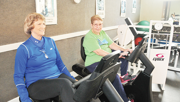 Linda Miller and Billie Wilson smile as they work out on the bikes at the fitness center. | Andrew Garner/Atmore Advance