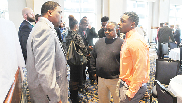 Escambia Academy running back Kris Brown (right) talks with former Alabama running back and NFL player Pierre Goode (left) after the sports banquet last week. | Andrew Garner/Atmore Advance