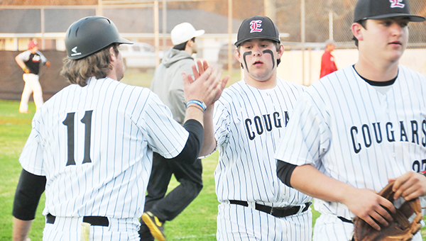 Escambia Academy's H.T. Fountain (center) high fives Cougars baseball coach Jeff Price during an earlier game this season. | Andrew Garner/Atmore Advance