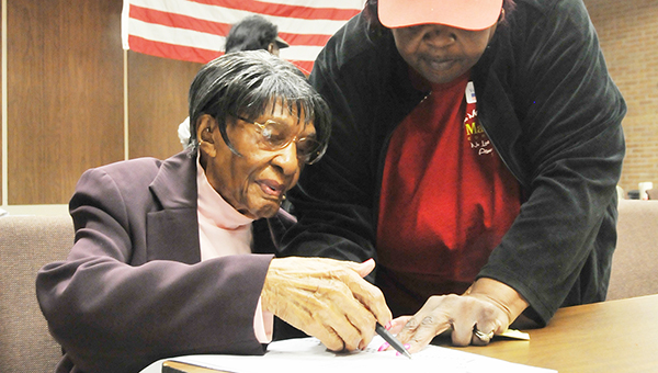 Barnetta Williams (left) votes during the 2016 Primary Election Tuesday. She is being helped by Lillie Johnson. | Andrew Garner/Atmore Advance