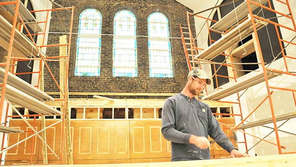 Carpenter Justin Dykes of Maxwell Construction Company works on the renovation project at First United Methodist Church Monday afternoon. | Andrew Garner/Atmore Advance
