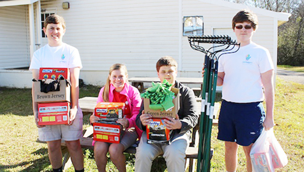 Pictured helping load the water in no particular order are:  Tre Williams, Lina Vinson, Alyssa Long, Jordan Blackmon,  Hannah White, Arial Scarbrough, Madison Stewart,  Ashlynn Wasdin,Travis Snider, Hannah Booker, Lori Ann McCullough, Rebecca Booker, Matthew Tuberville, Mary Dean, Drew Davis, Colton Thompson, and Meredith Shaddix. | Submiitted photo
