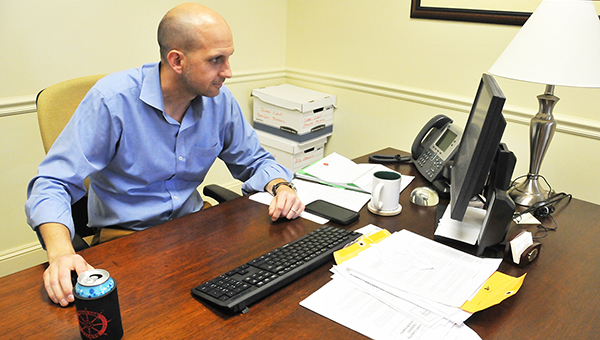 Wes Young is shown at his desk at United Bank. | Andrew Garner/Atmore Advance
