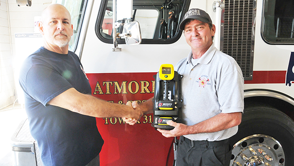 Atmore Fire Chief Ronald Peebles (right) is shown here with Firefighters Support Services President John Carre.   Andrew Garner/Atmore Advance