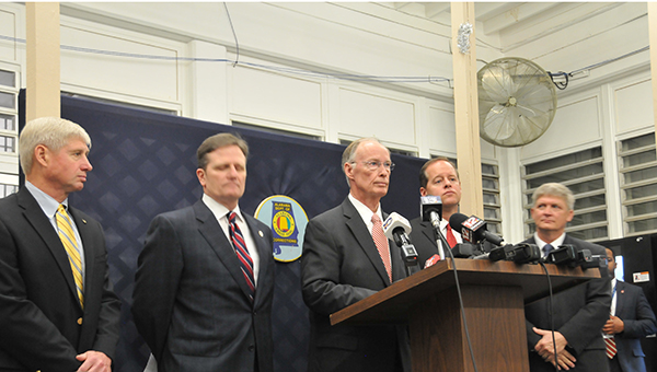 Alabama Gov. Robert Bentley is shown here with State Rep. Alan Baker, Alabama Department of Corrections Commissioner Jeff Dunn, Sen. Cam Ward and Sen. Greg Albritton during a press conference following a tour of Holman Correctional Facility. | Andrew Garner/Atmore Advance