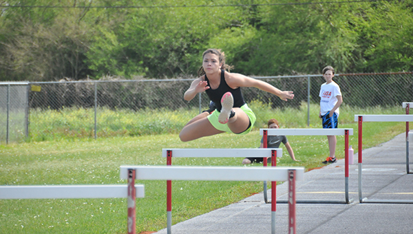 Escambia Academy's Mikayla Spruill practices the hurdle event last Monday before the Cougars' home meet. | Andrew Garner/Atmore Advance