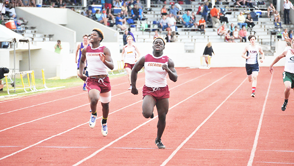Escambia Academy's Kris Brown (right) crosses the finish line as Patrick McGhee finishes right at Brown's heels.   Andrew Garner/Atmore Advance