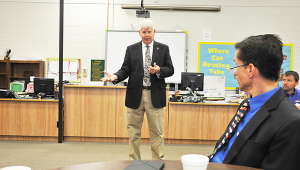 Atmore Mayor Jim Staff speaks to the crowd that gathered at Escambia County Middle School last week. | Andrew Garner/Atmore Advance