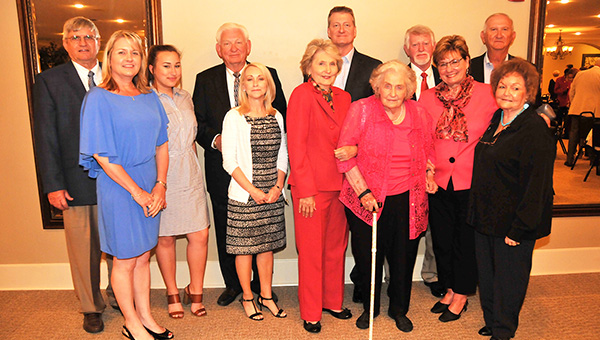 Shown in no particular order: Lou and Dana Vickery; Rebecca Carlin; Priscilla and Billy Wilder; Lance Vickery; Earl Miller and Rita Miller; Aurora Crook; and Anna Ruth Vickery pose for a photo after the Hall of Fame banquet Saturday night.  | Andrew Garner/Atmore Advance