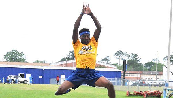 Escambia County's Anthony Fountain practices the long jump event last week. | Andrew Garner/Atmore Advance