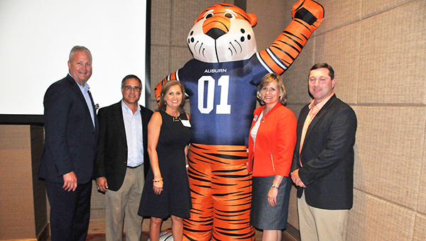 Auburn Athletic Director Jay Jacobs, Equestrian Coach Greg Williams, Edie Jackson, Gretchen VanValkenburg and AU Baseball Coach Butch Thompson pose for a picture at the banquet. |                Andrew Garner/Atmore Advance