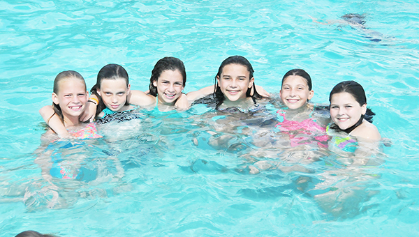 Area kids were having a splish-splashing good time at Tom Byrne Park pool last week to beat the heat. Above: Julie Conway, Kenna Alverson, Braylen Alverson, Ruthie Huskey, Rilee Huskey and Hillary Huskey smile for the camera while in the pool. | Savannah Peak/Atmore Advance