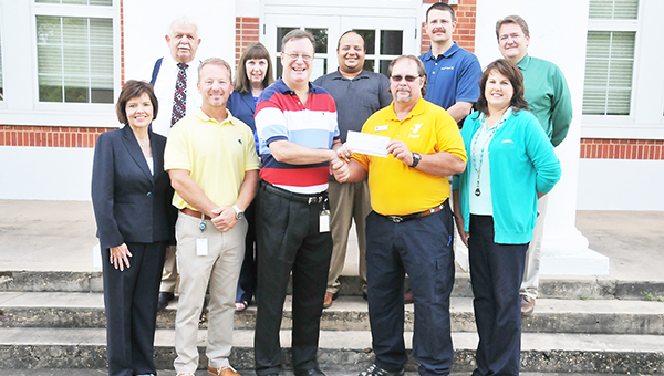 Alabama Power General Manager Ricky Martin presents a check for $10,000 to Atmore Area YMCA CEO Paul Chason Friday morning. Also shown in the picture include  YMCA board members Don Fletcher, Shirley Darby, Alex Alvarez, Alex Jones, Pete Emerson, AP External Affairs Manager Beth Thomas, AP Residential Marketer Lee Hall and YMCA Board Member Leeann Allen. | Andrew Garner/Atmore Advance