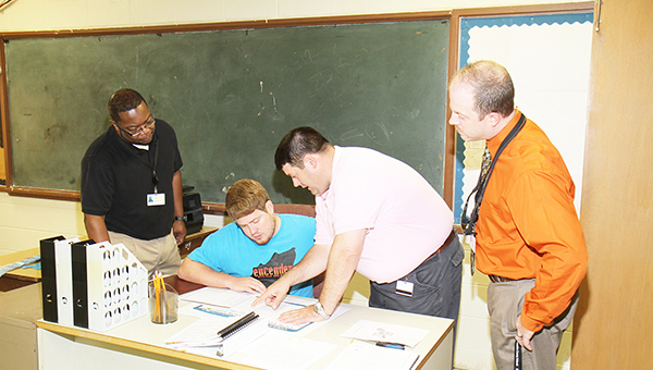 A new school year began for Escambia County today. Shown above from L to R: ECHS Assistant Principal Kevin Everett, ECHS Math Teacher Jonathan McMath, ECHS Principal Dennis Fuqua and ECHS Assistant Principal Randall Jackson.   walt butler/atmore advance