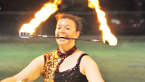 Brianna Smith juggles three fire batons during Northview's game at J.U. Blacksher last week. | Andrew Garner/Atmore Advance