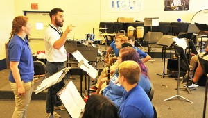 Escambia County Middle School Band Director Dan Akins works with high school band members Monday.   Andrew Garner/Atmore Advance