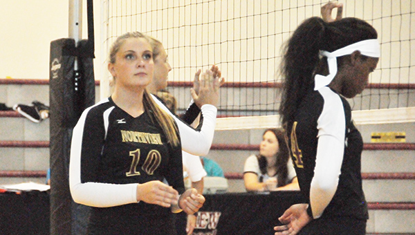 Northview's Bailey Spann (10) gets ready before a serve tonight.   Andrew Garner/Atmore Advance