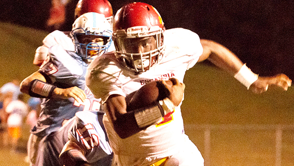 Escambia Academy's Louie Turner runs the ball around the left end during last week's game at Pickens Academy. | Photo by Ditto Gorme