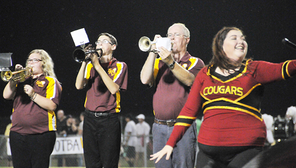Escambia Academy band director John Bell (center) plays the trumpet during an earlier game this season. | Andrew Garner/Atmore Advance
