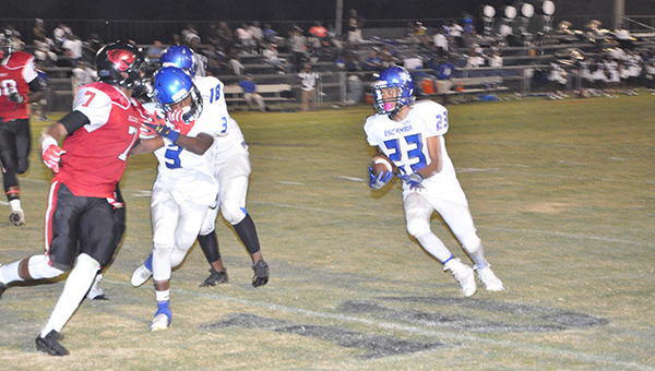 Escambia County's Deandre Mitchell rushes for a gain earlier tonight. | Lee Peacock/The Evergreen Courant