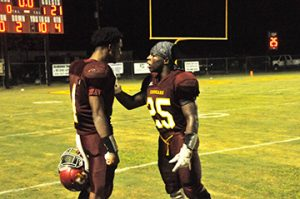 EA senior running back Kris Brown (right) consoles Louie Turner after the Cougars' loss tonight. | Andrew Garner/Atmore Advance