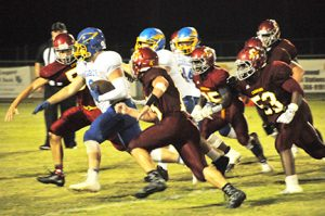 A host of EA defenders chase Watts. | Andrew Garner/Atmore Advance