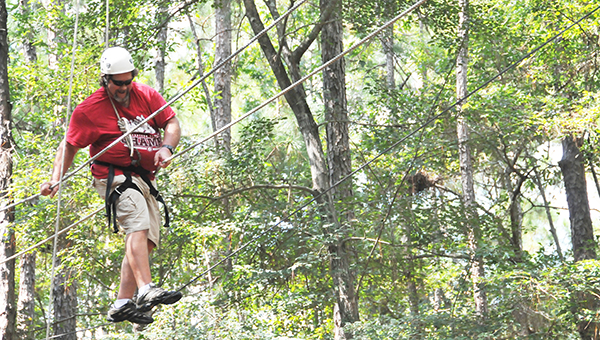 Atmore Area YMCA President and CEO Paul Chason goes through the ropes course at Camp Beckwith. | Andrew Garner/Atmore Advance