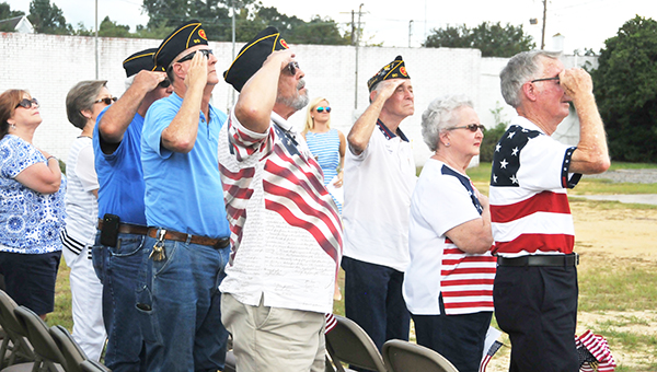 Members of the Billy Glenn Rushing Post 90 of the American Legion salute the American Flag Saturday morning during the flagpole dedication ceremony. | Andrew Garner/Atmore Advance
