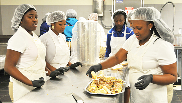 Escambia County High School culinary arts students prepare pastries for the Breakfast with an Elected Official event last Wednesday.   Andrew Garner/Atmore Advance