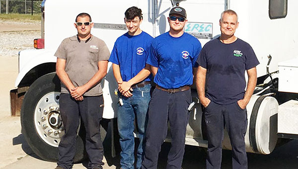 EREC crewmen Mark LeFlore, Philip Gandy, Jordan Jackson and Ken Blair will set up the bunk trailers and a shower trailer for use by restoration line crews. | Submitted photo