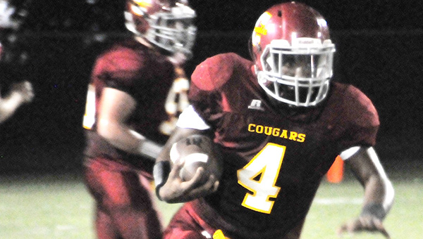 Escambia Academy's Louie Turner rushes for a gain during an earlier game this season. Turner has been rushing his way through a good year for the Cougars.   Andrew Garner/Atmore Advance