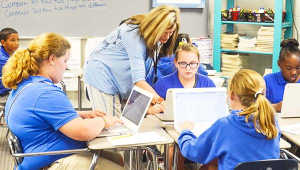 Mrs. Andrea Salter's reading class at W.S. Neal Middle School work on chromebooks during a lesson. | Corey Williams/The Brewton Standard