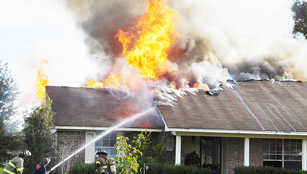Multiple fire crews battled a house fire on Rockaway Creek Road Monday afternoon. | Allison Brown/ Atmore Advance