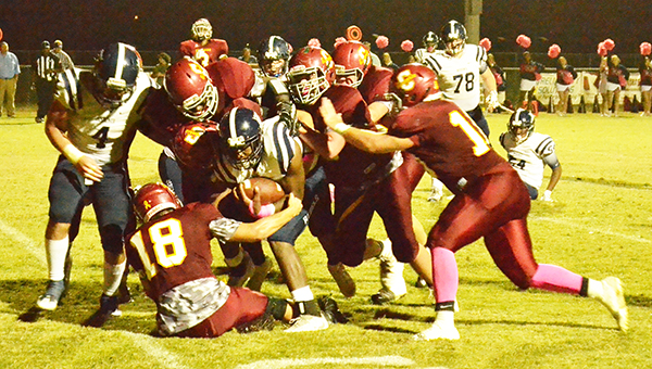 A host of Escambia Academy defenders tackled Bessemer Academy's Thomas Sims. | Andrew Garner/Atmore Advance