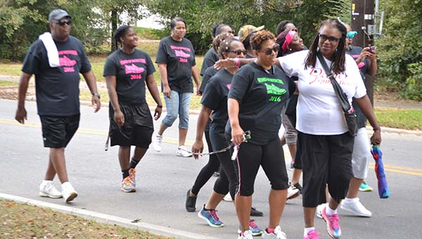 """Above: Women of Distinction members participate in the annual Walk-A-Thon """"A Walk to the Park"""" event Saturday.   Andrew Garner/Atmore Advance"""