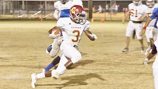 Escambia Academy's Fred Flavors advances the ball during last week's win at Lighthouse Christian. |                                                                                                       Photo by Ditto Gorme